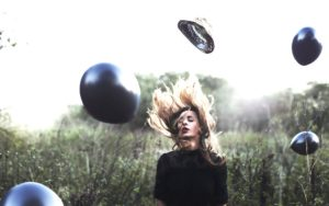 image of a girl surrounded by balloons