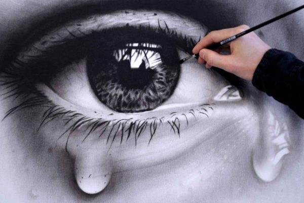 image of painting sad eyes