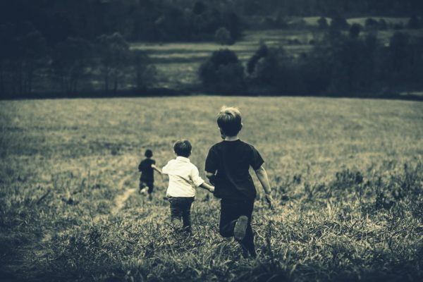 Kids running in a field image for utopia