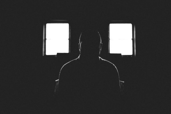 a person in a dark room photography for pitch black